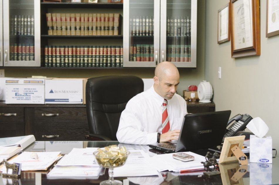 Dennis Ventrano, Jr. at His Desk